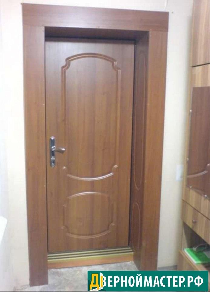 Металлическая железная дверь в квартиру с доборами. Отделка ударопрочным МДФ.